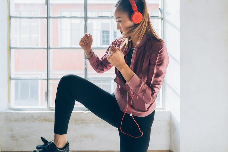 How to overcome limiting beliefs- a woman wearing headphones