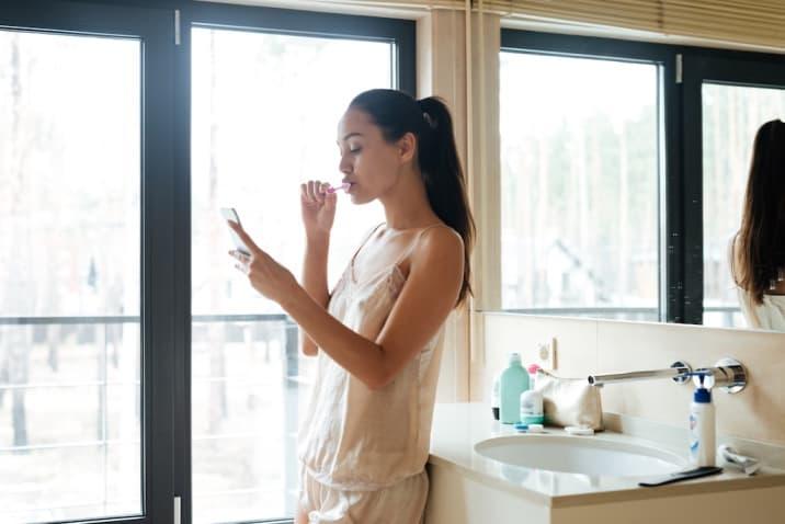 Girl in bathroom using phone