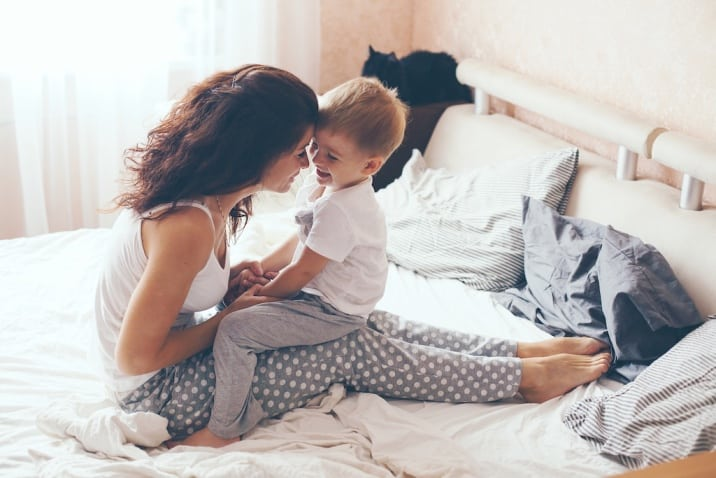 mom cuddling with son- productive sunday habits