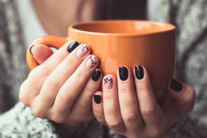 manicured nails and a coffee mug - productive sunday habits