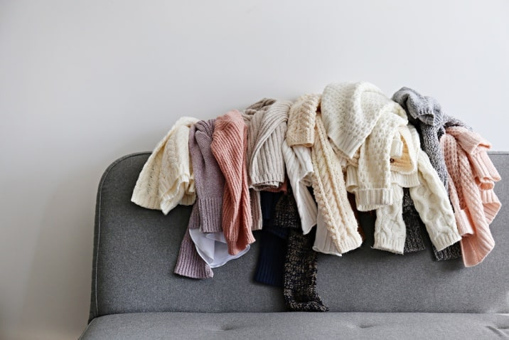 clothes cluttered on sofa- toxic thing to remove from life-clutter