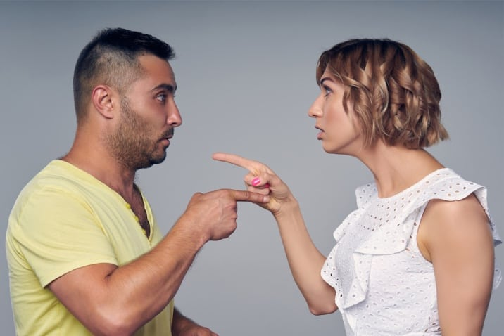 man and woman pointing at each other-toxic thing to remove from life- victim mentality