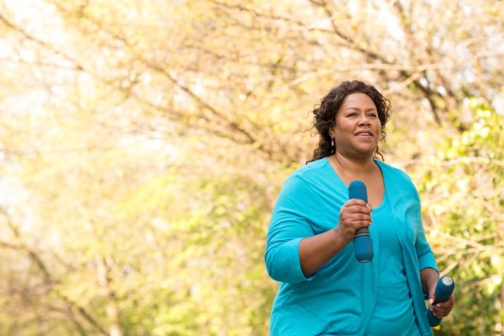 A plus-sized woman running to stay fit (believing in yourself and taking tiny steps)