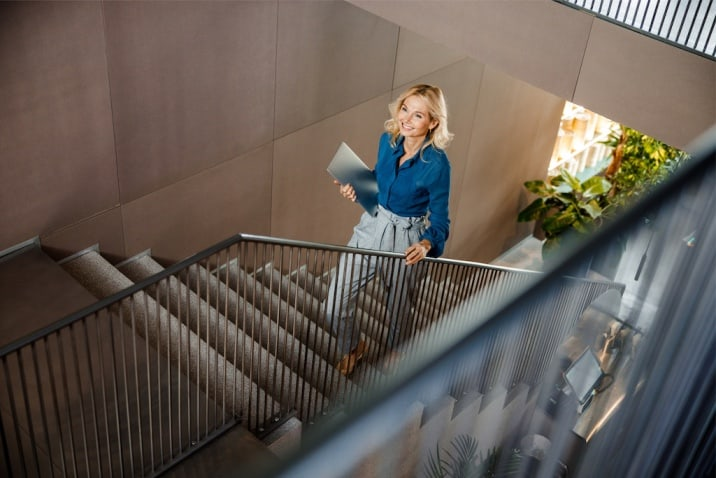 a woman climbing stairs - how to stop being a couch potato