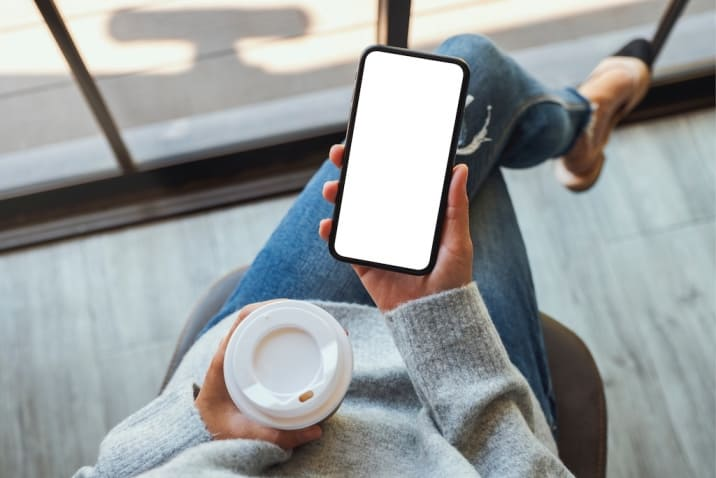 a woman checking her phone - how to stop being a couch potato